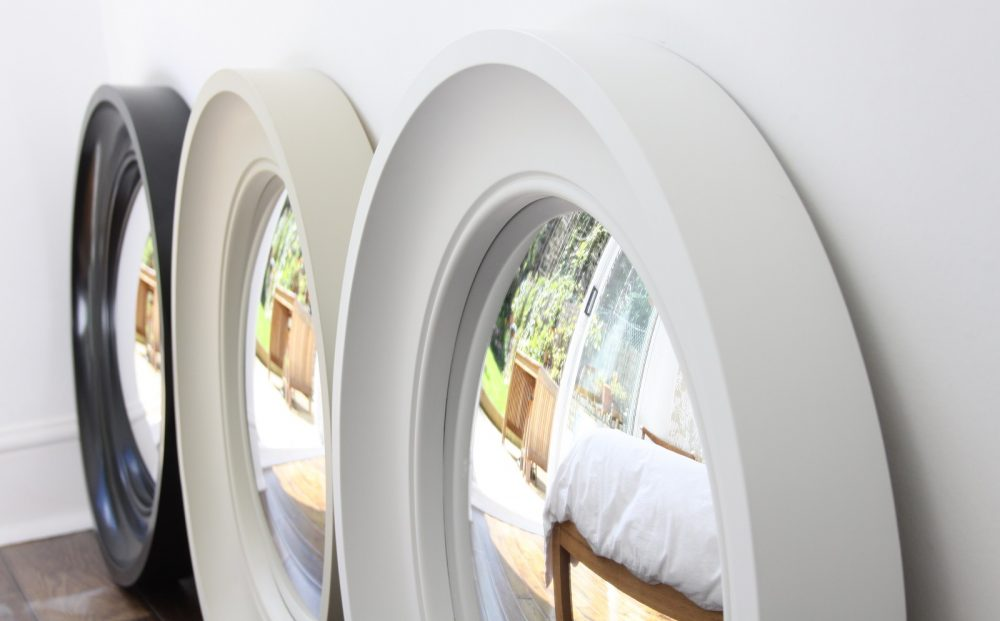 Image showing three Medium Cavetto decorative convex mirror in waxed black, fawn and off white finishes