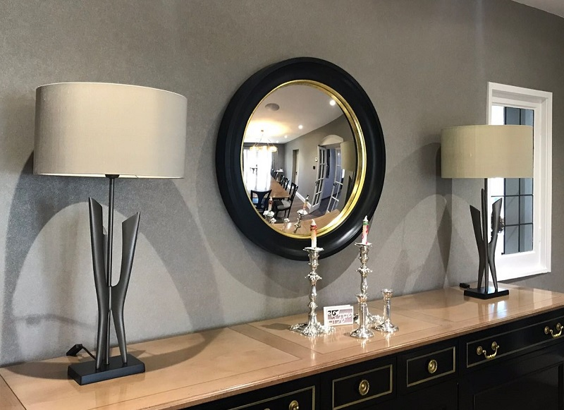 Black and gold large convex mirror image