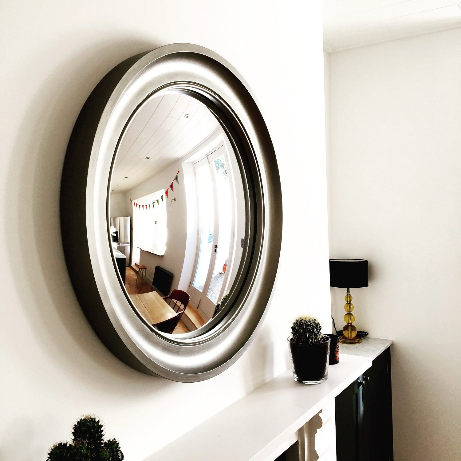 Convex And Round Mirrors Over A Fireplace Top Tips Omelo