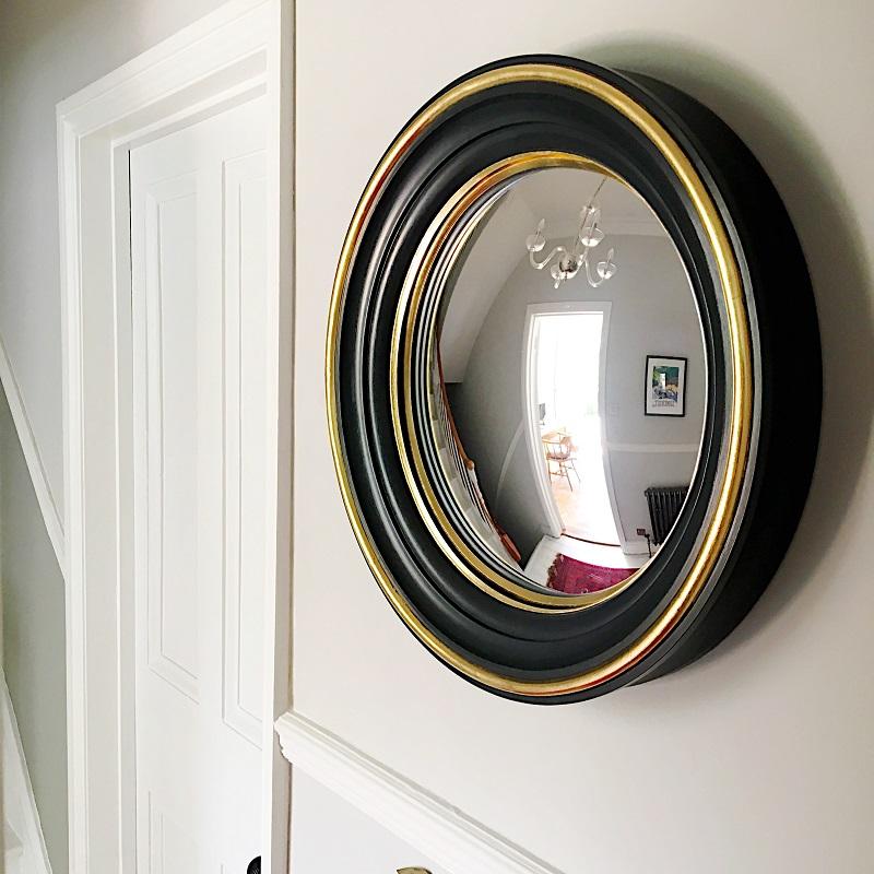 blue black brass convex mirror image