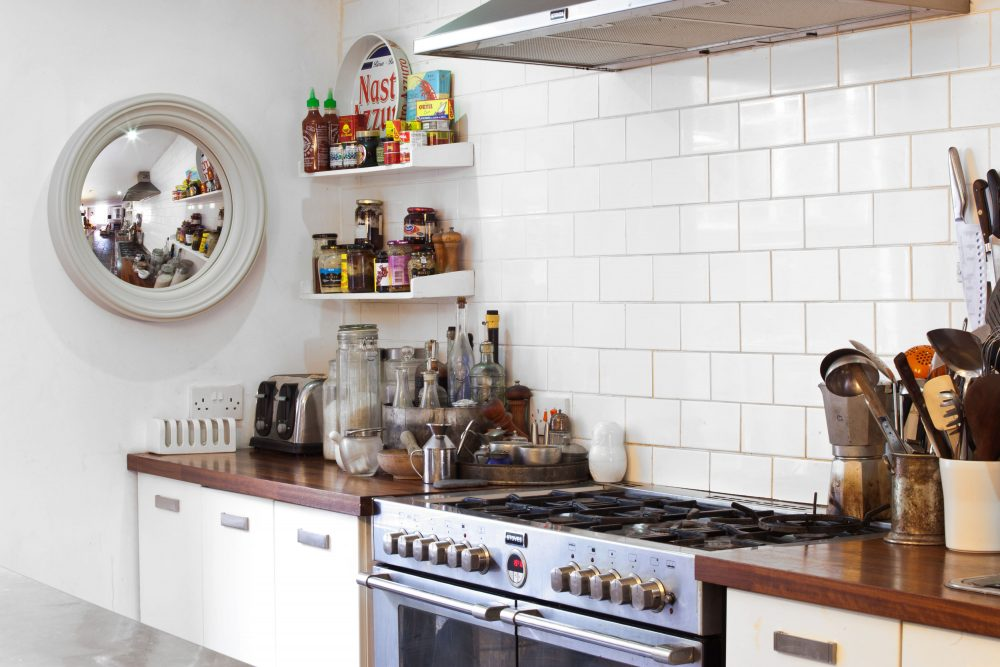 Image of a Medium Lucca convex mirror in palest grey finish hanging in a kitchen