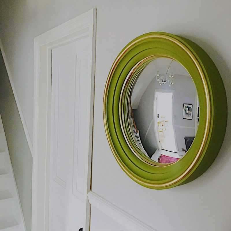 convex mirror hanging in hallway image