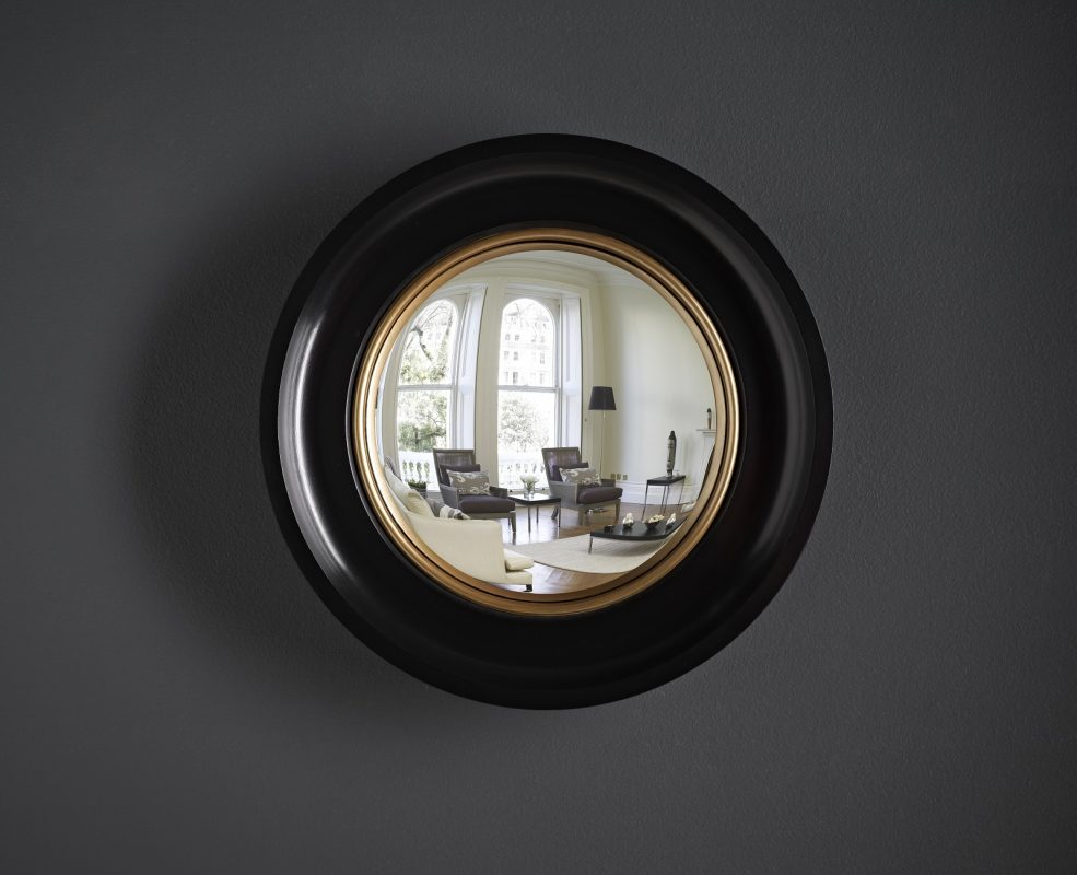 black and gold convex mirror image