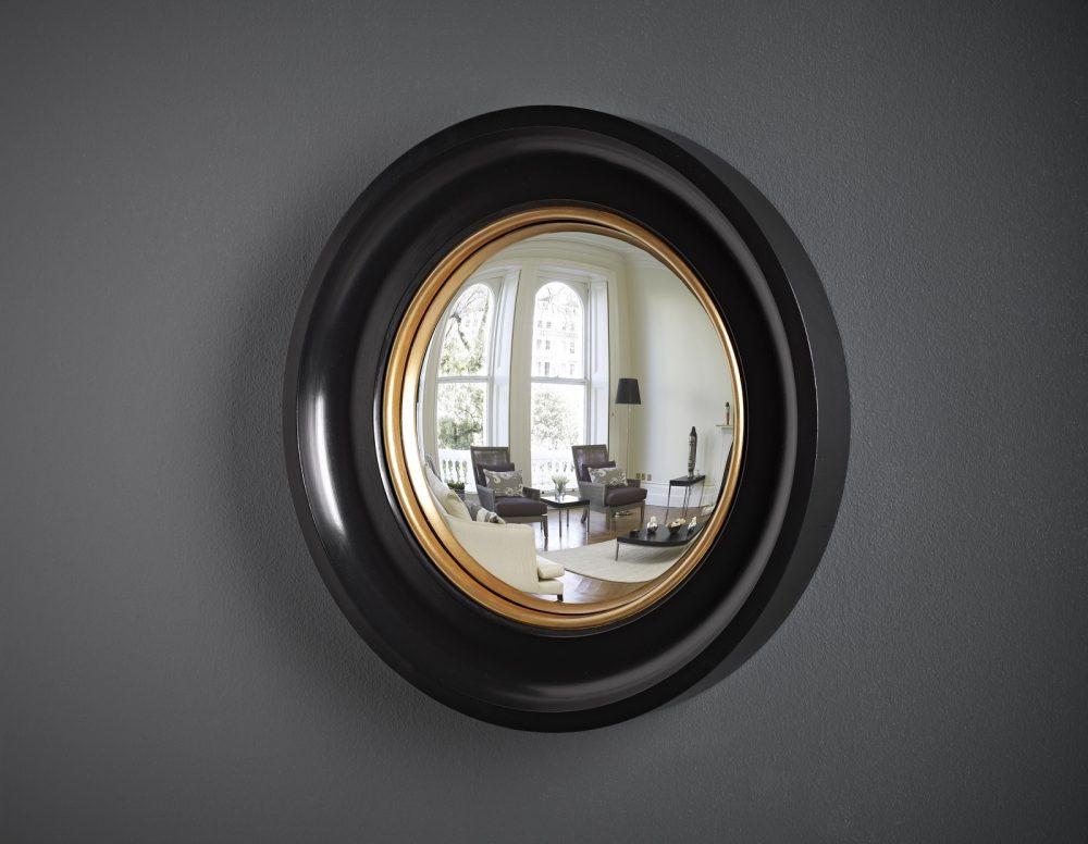 Image of small Cavetto decorative convex mirror in waxed black finish with a gold bead edge
