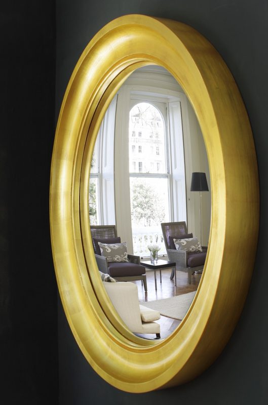 Large Cavetto decorative convex mirror in gold leaf finish image