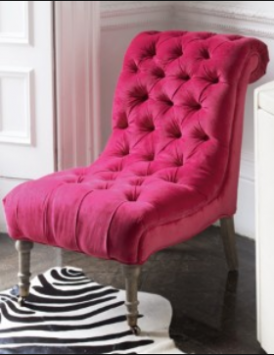 An antique nursing chair re-upholstered in a contemporary pop-coloured fabric