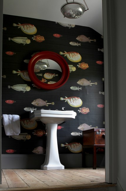 big round mirror hanging in bathroom image