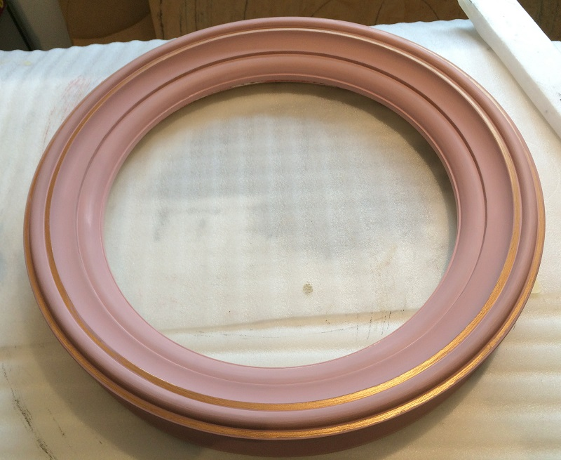 round mirror frame in pink and brass colour image